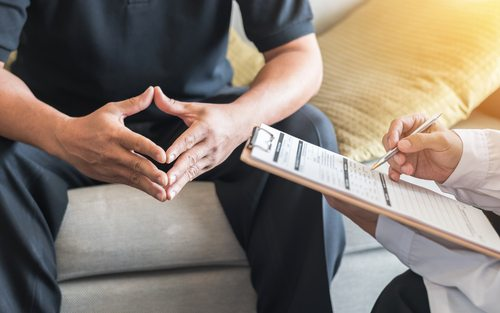 Patient discussing barbiturate addiction with his doctor