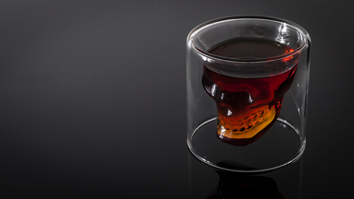 Dark liquor in a skull-shaped glass