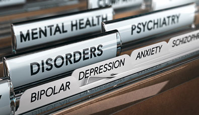 Various mental health diagnosis in a filing cabinet