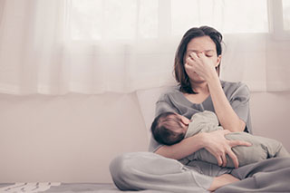 Woman experiencing post-partum anxiety