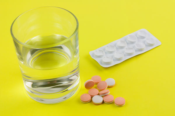 Estazolam pills and a glass of water