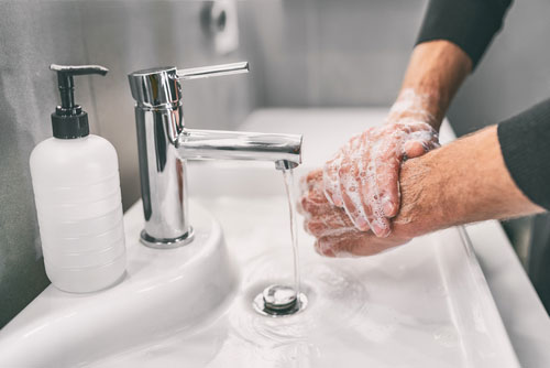 Drug-addicted person wahshing their hands to prevent covid-19