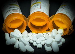 Oxycontin pills spilling out of bottles